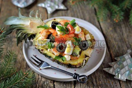 Food & Drink: Festive salad of shrimp kiwi olives soft cheese quail eggs cherry tomato in pineapple plates C #13718