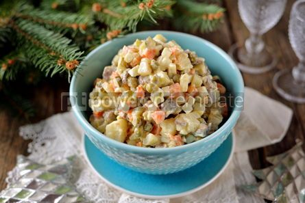 Food & Drink: Traditional Russian salad Olivier on an old wooden background Russian kitchen Rustic style #13725