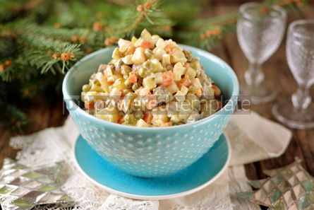 Food & Drink: Traditional Russian salad Olivier on an old wooden background Russian kitchen Rustic style #13726
