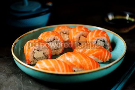Food & Drink: Philadelphia homemade sushi rolls in a blue plate on a black background #13759