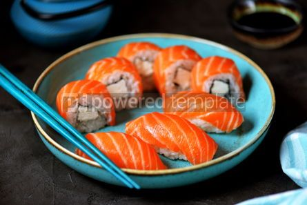 Food & Drink: Philadelphia homemade sushi rolls in a blue plate on a black background #13760