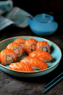 Food & Drink: Philadelphia homemade sushi rolls in a blue plate on a black background #13761