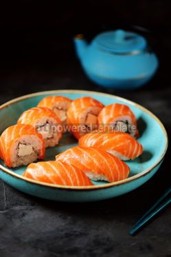 Food & Drink: Philadelphia homemade sushi rolls in a blue plate on a black background #13762