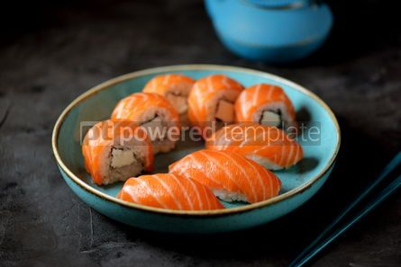 Food & Drink: Philadelphia homemade sushi rolls in a blue plate on a black background #13763