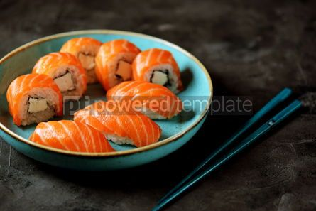 Food & Drink: Philadelphia homemade sushi rolls in a blue plate on a black background #13765