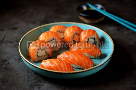 Food & Drink: Philadelphia homemade sushi rolls in a blue plate on a black background #13766