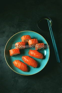 Food & Drink: Philadelphia homemade sushi rolls in a blue plate on a black background #13767