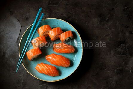 Food & Drink: Philadelphia homemade sushi rolls in a blue plate on a black background #13768