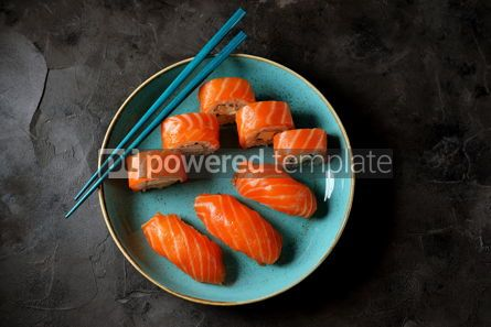 Food & Drink: Philadelphia homemade sushi rolls in a blue plate on a black background #13769