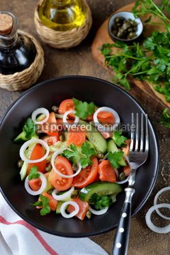 Food & Drink: Healthy salad of cherry tomatoes cucumber celery onions capers and parsley with salted salmon #13803