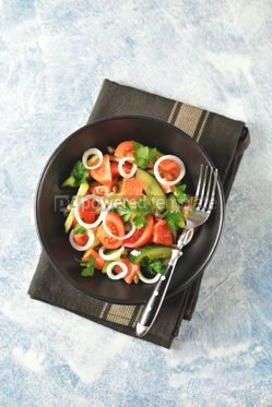 Food & Drink: Healthy salad of cherry tomatoes cucumber celery onions capers and parsley with salted salmon #13805