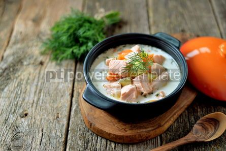 Food & Drink: Finnish wild salmon soup with cream on an old wooden background Rustic style #13822