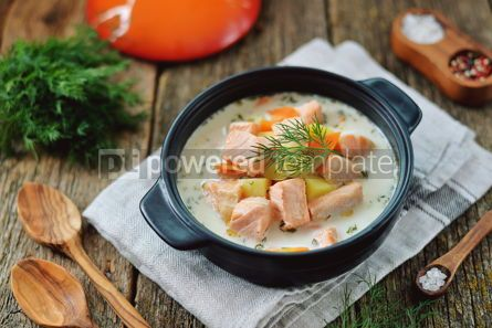 Food & Drink: Finnish wild salmon soup with cream on an old wooden background Rustic style #13826
