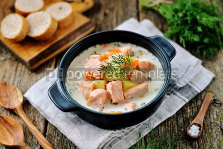 Food & Drink: Finnish wild salmon soup with cream on an old wooden background Rustic style #13827