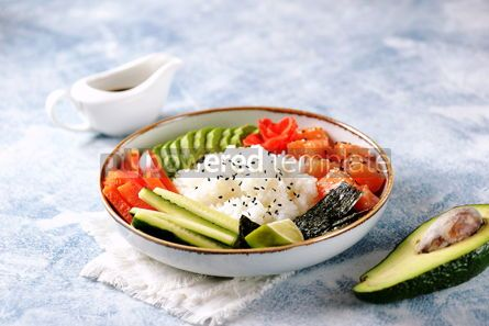 Food & Drink: Sushi bowl with rice salmon avocado cucumber sweet pepper ginger and sesame Healthy food #13843