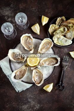 Food & Drink: Fresh oysters on a large sea salt with lemon #13881