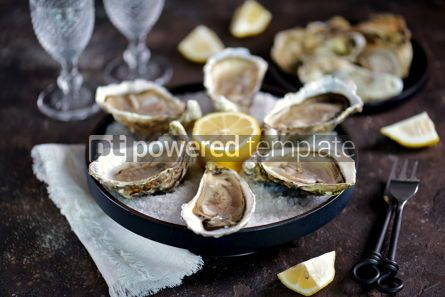 Food & Drink: Fresh oysters on a large sea salt with lemon #13882