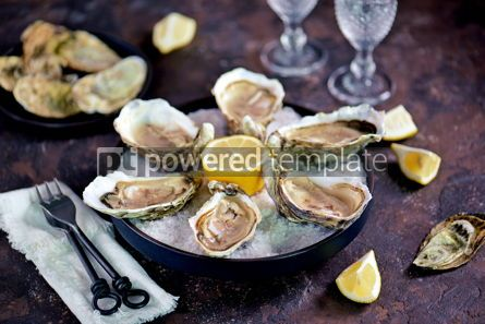Food & Drink: Fresh oysters on a large sea salt with lemon #13885