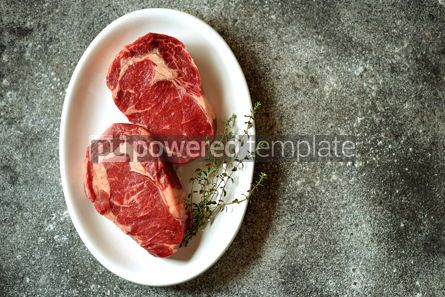 Food & Drink: Juicy raw steak with thyme on a gray background Organic healthy food Top view #13939