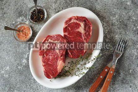 Food & Drink: Juicy raw steak with thyme on a gray background Organic healthy food Top view #13943