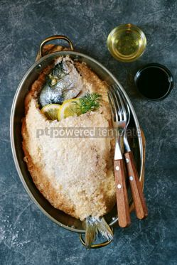 Food & Drink: Sea fish dorado fish baked in coarse salt mixed with egg white Healthy food Top view #13951