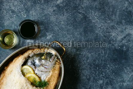 Food & Drink: Sea fish dorado fish baked in coarse salt mixed with egg white Healthy food Top view Copy cpace #13953