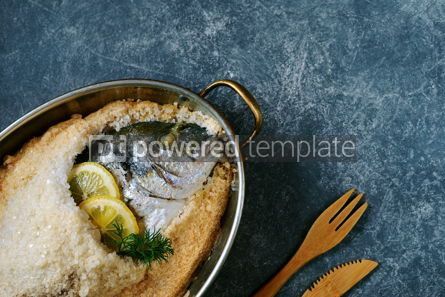 Food & Drink: Sea fish dorado fish baked in coarse salt mixed with egg white Healthy food Top view #13954