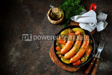Food & Drink: Roast Chicken sausages with potatoes onions carrots and mushrooms in a cast-iron pan #14099