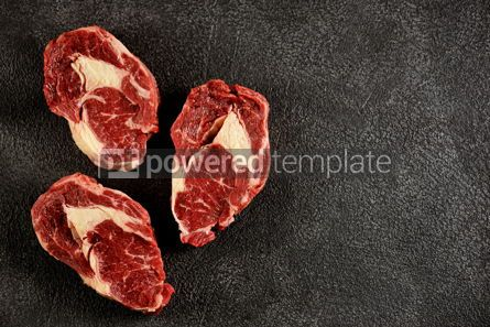 Food & Drink: Three raw fresh beef steaks rib eye on a black background Top view Copy space #14191