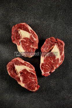 Food & Drink: Three raw fresh beef steaks rib eye on a black background Top view #14192