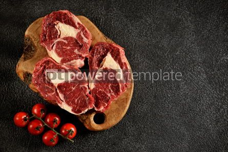 Food & Drink: Three raw fresh beef steaks rib eye on a black background Top view Copy space #14193