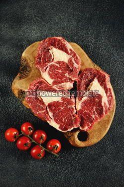 Food & Drink: Three raw fresh beef steaks rib eye on a black background Top view #14194