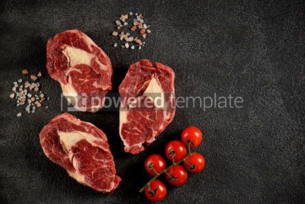 Food & Drink: Three raw fresh beef steaks rib eye on a black background Top view Copy space #14195