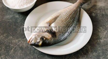 Food & Drink: Raw fresh dorado fish with sea salt on a black background #14210