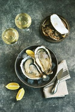 Food & Drink: Giant fresh uncooked oysters in a shell with lemon on ice Healthly food Top view #14257