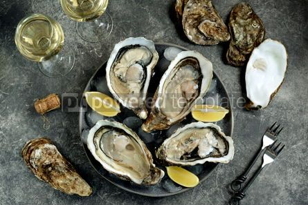 Food & Drink: Giant fresh uncooked oyster in a shell with lemon on ice Healthly food Top view #14281