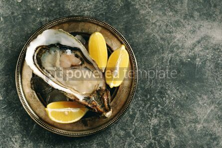 Food & Drink: Giant fresh uncooked oyster in a shell with lemon on ice Healthly food Top view #14286