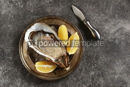 Food & Drink: Giant fresh uncooked oyster in a shell with lemon on ice Healthly food Top view #14287