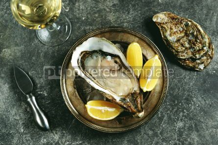 Food & Drink: Giant fresh uncooked oyster in a shell with lemon on ice Healthly food Top view #14288