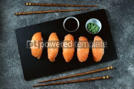 Food & Drink: Nigiri sushi with wild salmon on black serving board Top view #14335