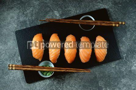 Food & Drink: Nigiri sushi with wild salmon on black serving board Top view #14336