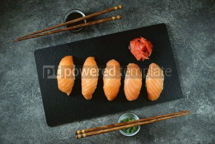 Food & Drink: Nigiri sushi with wild salmon on black serving board Top view #14337