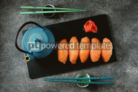 Food & Drink: Nigiri sushi with wild salmon on black serving board Top view #14338