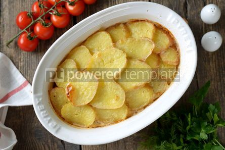 Food & Drink: Potato casserole with onions sour cream on an old wooden background Rustic style #14368