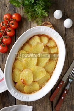 Food & Drink: Potato casserole with onions sour cream on an old wooden background Rustic style #14369