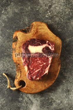 Food & Drink: Fresh raw rib eye steak on a wooden board Organic food #14374