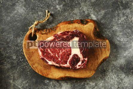 Food & Drink: Fresh raw rib eye steak on a wooden board Organic food #14375