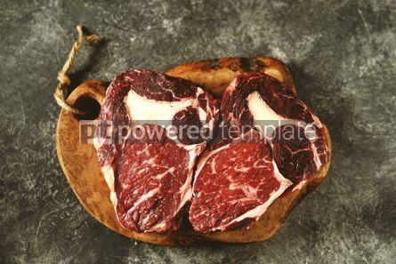 Food & Drink: Two raw fresh beef steak rib eye on olive board on dark background #14376