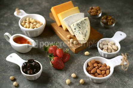 Food & Drink: Various types of cheeses with olives nuts fruits and honey Appetizer for a wine party #14378