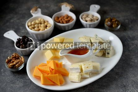 Food & Drink: Various types of cheeses with olives nuts fruits and honey Appetizer for a wine party #14379